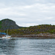 Stock Photo: Fishing boat in fjord of Lofoten