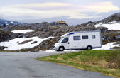 Caravan van on high-mountainous road of Norway — Stock Photo
