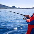 Fisherman with a spinning — Stock Photo #3481845