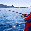 Stock Photo: Fisherman with a spinning