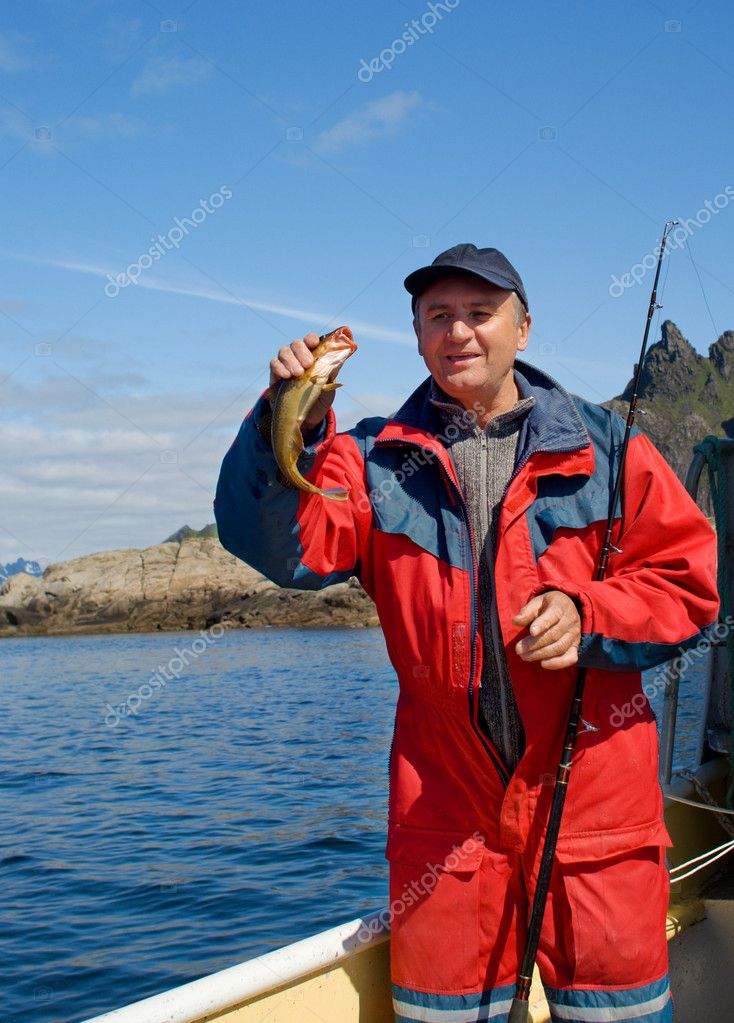 Fisherman with big fish on the boat near the Lofoten island — Stock Photo #3499136