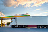 White truck is at a fuel station. — Stock Photo