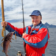 Fisherman with a fish on Lofoten island — Stock Photo