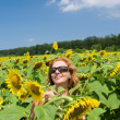 The beautiful woman in the field of sunflowers — Stock Photo