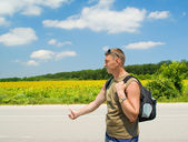 Man stops the car on a road roadside — Stock Photo
