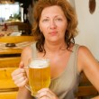 The young woman with a beer mug — Stock Photo