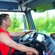 The driver at the wheel of the truck — Stok fotoğraf