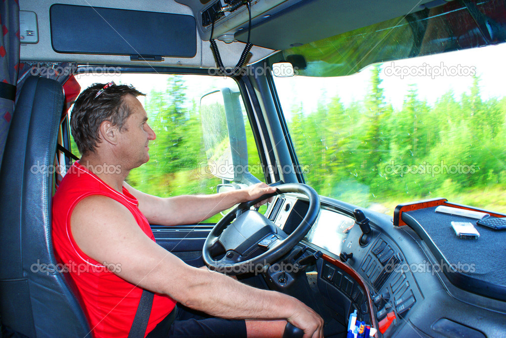 The driver at the wheel of the truck  Stock Photo #3701728
