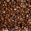 Stock Photo: Backround of many coffee grains