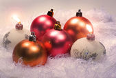 Christmas candles and red spheres — Stock Photo