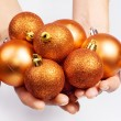 Female hands with Christmas spheres — Stock Photo