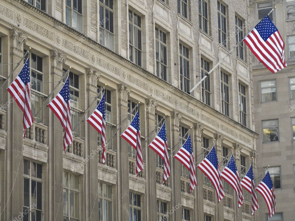 Many american flags hissed on one building — Stock Photo #3092493