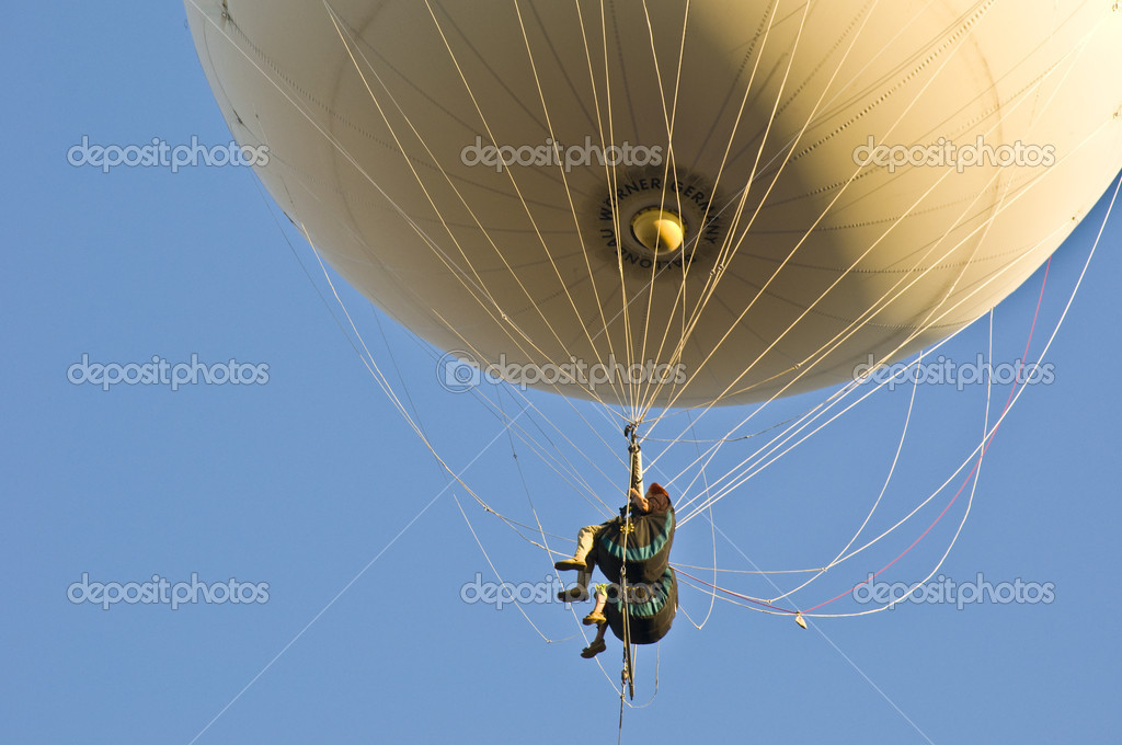 Having a fun time on a sunny day flying with an hot air balloon  Stock Photo #3094887