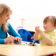 Teacher and girl play with plasticine — Stock Photo #3066363