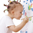 Little girl paint on a board — Stock Photo #3087961