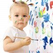 Little girl paint on a white board — Stock Photo #3087978