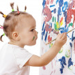 Little girl paint on a board — Stock Photo #3088013