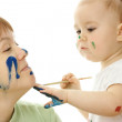 Little girl paint on her mother — Stock Photo #3088042
