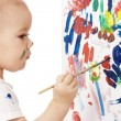 Stock Photo: Little girl paint on a board