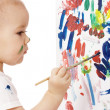 Little girl paint on a board — Stock Photo