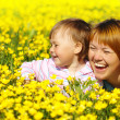 Stock Photo: Mother and child play on meadow