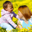 Mother and child play on meadow — Stock Photo #3088746