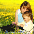 Mother and her child play on meadow — Stock Photo #3088769