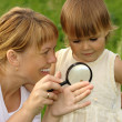 Child with mother looking at snail — Stock Photo #3088890
