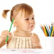 Cute child play with color pencils — Stock Photo