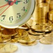 Clock dial and golden coins — Stock Photo