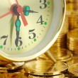 Stock Photo: Clock dial and golden coins