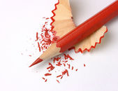 Sharpened red crayon on shavings — Stock Photo