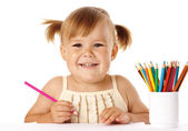 Child play with crayons and smile — Stock Photo