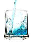 Blue drink is being poured into glass — Stock Photo