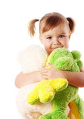 Cute girl embracing her soft toys — Stock Photo