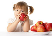 Cute child with apples — Stock Photo