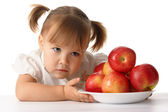 Suspicious child with apples — Stock Photo