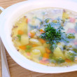 Vegetable soup with brussels and pea - Stock Photo