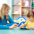 Royalty-Free Stock Photo: Teacher with child in preschool