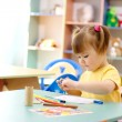 Little girl draw with color markers — Stock Photo #3096580