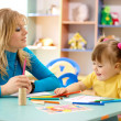 Teacher with child in preschool — Stock Photo #3096587