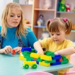 Teacher and preschooler — Stock Photo