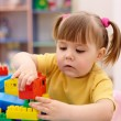 Little girl play with building bricks — Stock Photo #3096630
