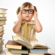 Little girl with books wearing glasses — Stock Photo