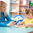 Royalty-Free Stock Photo: Teacher and child in preschool