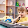 Cute child with electronic piano — Stock Photo