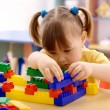 Stock Photo: Cute child play with building bricks