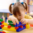 Cute child play with building bricks — Stock Photo