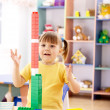 Cute child play with building bricks — Stock Photo #3099488
