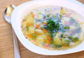 Vegetable soup with brussels and pea — Stock Photo
